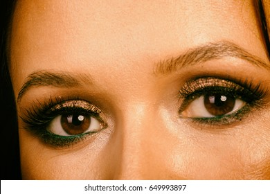 Great professional make-up eyes. Glitter, eye shadow, highlighter, eyeliner. Eye of girl close-up.