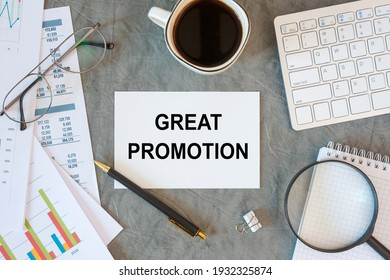 Great Promotion is written in a document on the office desk with office accessories, diagram and keyboard