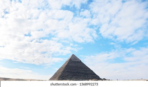 The great pyramid of Giza with beautiful sky with clouds