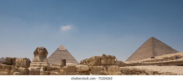Great pyramids of Egypt with the sphinx in front.