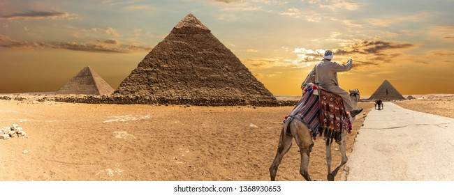 The Great Pyramids of Giza and a bedouin, desert panorama.