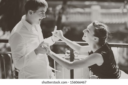 Great relationship. Young caucasian couple together. Black and white picture.