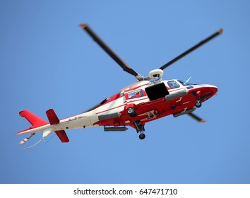 Great Relief Helicopter flies fast in the blue sky during the emergency
