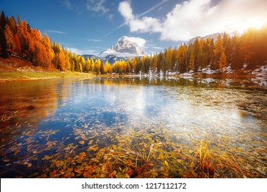 Great rocks over the lake Antorno in National Park Tre Cime di Lavaredo. Location Misurina, Dolomiti alps, Province of Belluno, Italy, Europe. Scenic image of autumn day. Discover the beauty of earth.