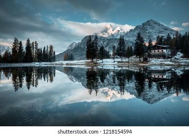 Great rocks over the lake Antorno in National Park Tre Cime di Lavaredo. Location Misurina, Dolomiti alps, Province of Belluno, Italy, Europe. Scenic image of autumn day. Discover the beauty of earth.