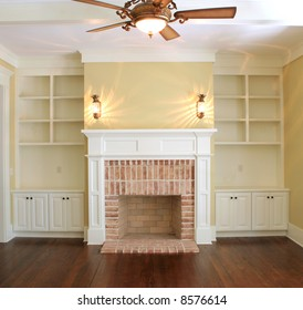 great room with fireplace and sconce lights