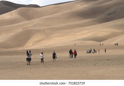 GREAT SAND DUNES NATIONAL PARK, COLORADO - APRIL 12, 2010: people walking on the Great Sand Dunes in Colorado