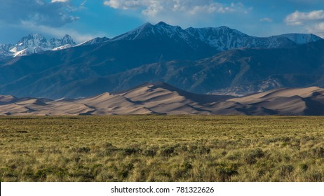 Great sand dunes and snow capped peaks in Colorado