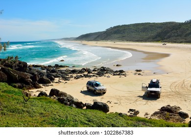 Great Sandy National Park, Queensland, Australia - December 19, 2017. 40-mile beach in Great Sandy National Park in Queensland, Australia, with 4WD Nissan and Toyota cars parked on sand, and people.