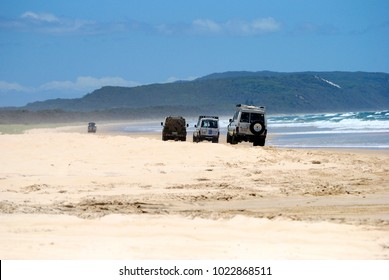Great Sandy National Park, Queensland, Australia - December 19, 2017. Three 4WD vehicles driving on sand of 40-mile beach in Great Sandy National Park, QLD.