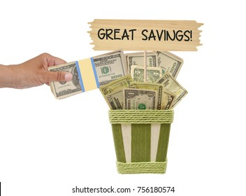 Great Savings! Wood sign Hand placing One hundred dollar bills in basket with US paper currency white background