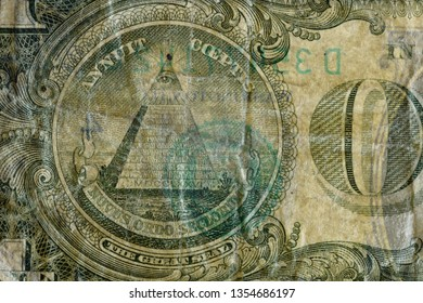 The Great Seal pyramid, highly magnified surface of used 1 dollar banknote with visible details of cotton fiber paper, with all flaws, watermarks and traces of usage.
