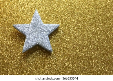 great silver five-pointed star in the golden background