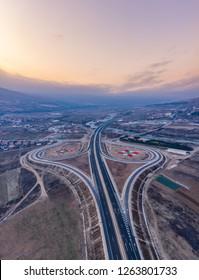 Great sky/view over a cloverleaf motorway junction in Europe