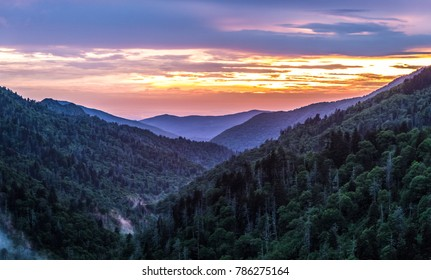 Great Smoky Mountain Sunset Background. Great Smoky Mountain sunset panorama over the many layers and ridges of the beautiful Appalachian Mountains of Tennessee.