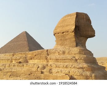 Great Sphinx of Giza at the Bottom Pyramid of Cheops.
