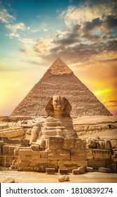Great sphinx and pyramid under bright sun