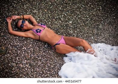great sport woman lying on a big beach