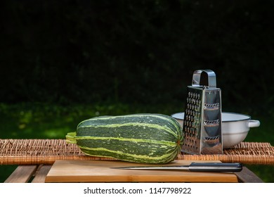 Great spotted zucchini in the garden on the table