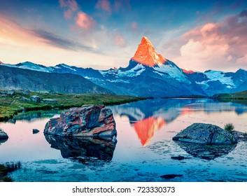 Great summer scene of the Stellisee lake. Splendid evening view of Matterhorn (Monte Cervino, Mont Cervin) in Swiss Alps, Switzerland, Europe. Beauty of nature concept background.