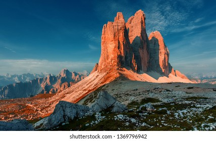 Great sunny view of the National Park Tre Cime di Lavaredo, Panoramic view of three spectacular mountain peaks. Awecome nature landscape. Amazing mountain valley under sunlight. Dolomites Alps.