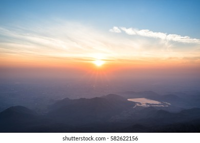 Great sunrise above the mountain valley and morning mist.
