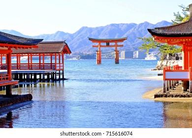 The great Torii (Red) at Itsukushima Shrine is a Shinto shrine on the island of Itsukushima aka Miyajima. Japan.