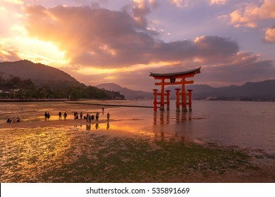 The great Torii  Symbol of Miyajima island in sunset tiwilight and  waters  dropping time