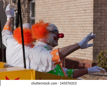 GREAT TORRINGTON, ENGLAND - MAY 4:  Clowns in the Grand Carnival on May 4, 2013 in Great Torrington, England. The annual street parade closes the May Fair which has taken place since the 16th century