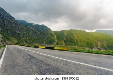 great Transfagarasan rout in stormy summer weather. great transport concept. gorgeous high altitude landscape on a rainy day. winding serpentine in Southern Carpathian Fagaras Mountains of Romania