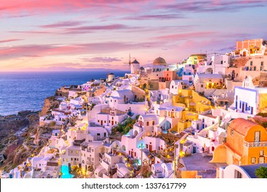Great twilight view of Santorini island. Sunset on the famous Oia city, Greece, Europe