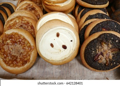 a great variety of sweet cakes on a market