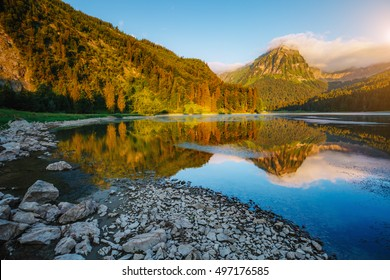 Great view of alpine pond Obersee at twilight. Popular tourist attraction. Picturesque and gorgeous morning scene. Location famous place Nafels, Mt. Brunnelistock, Swiss alps, Europe. Beauty world.