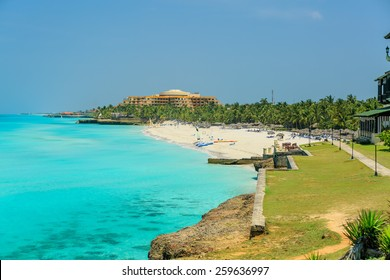 great view of amazing, gorgeous inviting tropical beach with people in background on sunny summer day