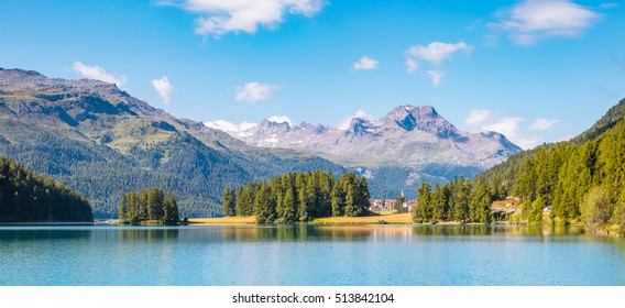 Great view of the azure pond Champfer in alpine valley. Popular tourist attraction. Picturesque and gorgeous scene. Location Swiss alps, Silvaplana village, district of Maloja, Europe. Beauty world.
