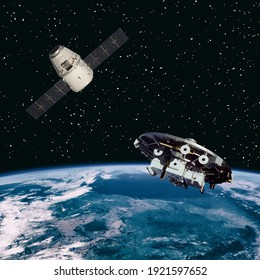 Great view of earth and spaceships. The elements of this image furnished by NASA.