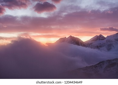 Great view of the foggy valley in Gran Paradiso,  Alps, Italy,  dramatic scene, beautiful world. colourful autumn morning,scenic view with cloudy sky, dawn in mountain landscape, scenic wallpaper