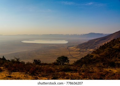 great view of most of the ngorongoro crater national park with the huge lake and the crater edges surrounding the grassland