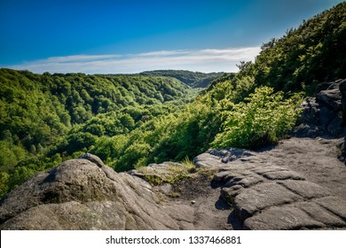 Great view over the green and lush forest valley of Soderasens National Park from cliff Sweden