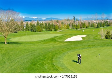 Great view (panorama, outlook ) at the beautiful golf course with the mountains at the back.