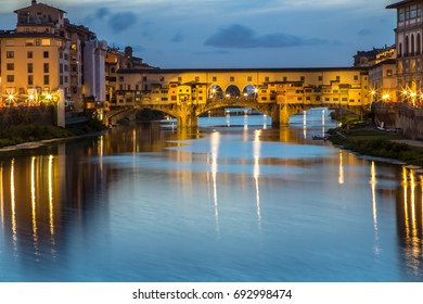 Great View to the Ponte Vecchio at night, most famous bridge of Florence, Italy