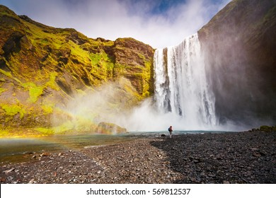 Great view of Skogafoss waterfall and scenic surroundings. Dramatic and picturesque scene. Popular tourist attraction. Location famous place Skoga river, highlands of Iceland, Europe. Beauty world.