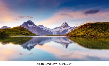 Great view of the snow rocky massif. Popular tourist attraction. Dramatic and picturesque scene. Location place Bachalpsee in Swiss alps, Grindelwald valley, Bernese Oberland, Europe. Beauty world. - Shutterstock ID 582496024