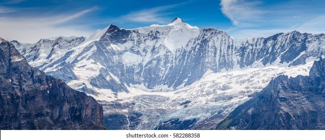 Great view of the snowy massive rock in sunlight. Picturesque and gorgeous scene. Location place Swiss alps, Grindelwald valley, Bernese Oberland, Europe. Discover the world of beauty.