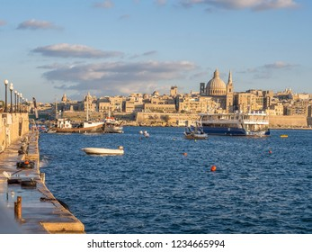 The great view of Valletta Capital City with boats in the sea bay in the foreground. Sliema, Malta