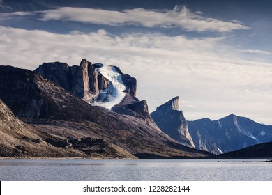 Great view of Weeping Glacier on Mount Breadablik with Mount Thor in background in Akshayuk Pass, Nunavut