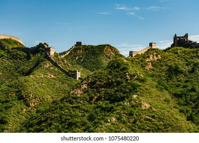 Great Wall of China extending along mountain tops as far as the eye can see