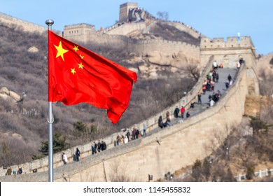The Great Wall of China on the background and chinese red flag
