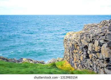 Great wall of Peel Castle up on St Patrick's Isle in city of Peel, Isle of Man