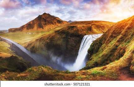Great waterfall Skogafoss in south of Iceland near the town of Skogar. Beautiful autumn landscape.